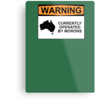 WARNING: CURRENTLY OPERATED BY MORONS Metal Print
