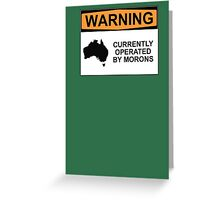 WARNING: CURRENTLY OPERATED BY MORONS Greeting Card