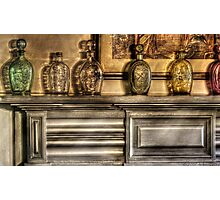Mantle with a collection of bottles Photographic Print