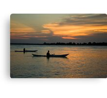 Paddling Thru The Sun Canvas Print