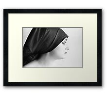 The best way to turn a woman's head is to tell her she has a beautiful profile.   Framed Print