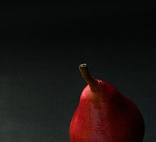Red pear over dark background by katiawhite