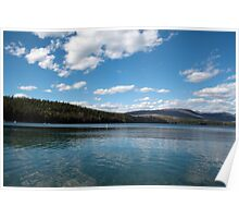 Beautiful lake, mountain, blue sky and white clouds in Glacier National Park. Landscape photography. Poster