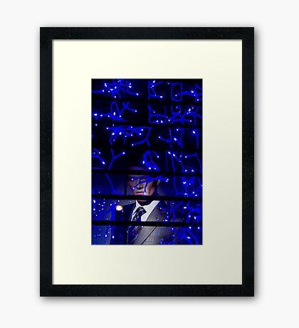 A Man behind Bars Framed Print