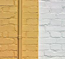 Yellow white bricks wall by Ron Zmiri