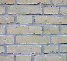 Wall of light yellow bricks by Ron Zmiri