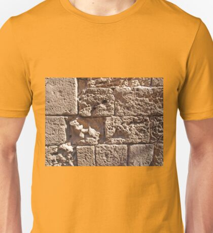 Old sea sand stone wall background Unisex T-Shirt