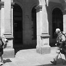 Two pilgrims arrive at their destination by Richard McCaig