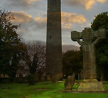 Saint Colmcille's Monastery - Round Tower and High Cross by S.I. Sheehan