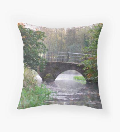 A BRIDGE OVER STEAMY WATER Throw Pillow