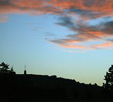 Peaceful Sunset over Laferla Cross  by Christian  Zammit