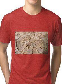 Display of stone floor tiles circle Tri-blend T-Shirt