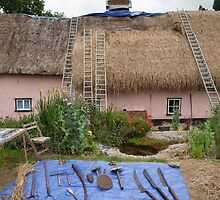 Thatching in progress by Christopher Cullen