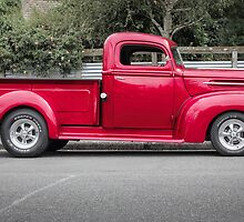 red pickup by Mike Warman
