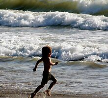 Candid Child playing in the surf by Robin Fortin IPA
