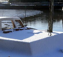 Snowy covered boat by Roxy J