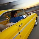 Yellow Ford XM in action by John Jovic