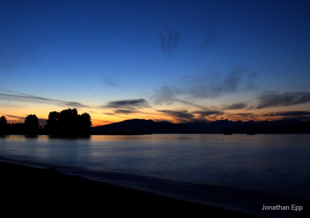 Summer sunset over a frozen ocean by Jonathan Epp