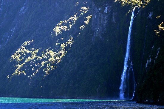 Waterfall light, Milford Sound, New Zealand by Lisa Wilson