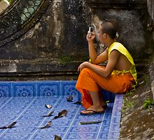 Young Buddhist Monk and his mobile phone  by Cvail73