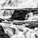 Iguaza Falls - back in close - monochrome by photograham