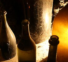 Italian wine bottles in cellar, Poppi, Italy by damonmattson