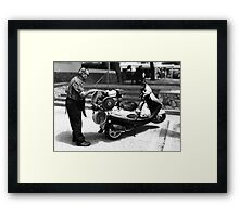 The daily grind. Framed Print