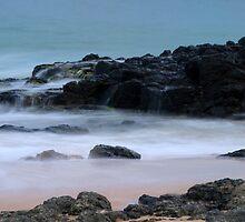 washed rocks by Ian Robertson