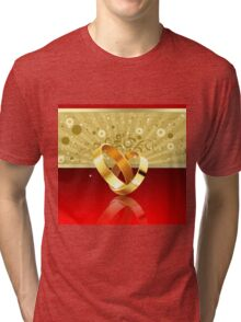 Romantic background with wedding rings 2 Tri-blend T-Shirt