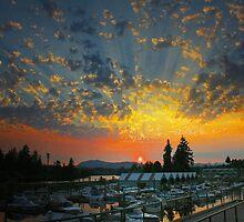Sunset cloudbursts at the marina. by axieflics