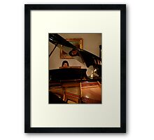 The Piano and its Player Framed Print