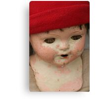 doll head with red cap Canvas Print