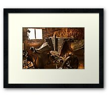 Old style agricultural tools in a wooden shed. Framed Print