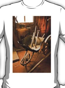 Old style agricultural tools in a wooden shed T-Shirt