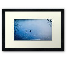 Man, dog, frozen lake Framed Print