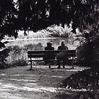 Old couple on a bench in Cologne by Adam Irving