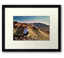 A local beduin looks out over the desert mountains Framed Print