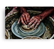Hands of a potter  Canvas Print