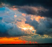 sunset through grey storm clouds  by PhotoStock-Isra
