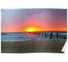 Poles in the sea the remains of a wharf at sunset Poster