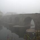 The old bridge in the fog by wesleyj1954