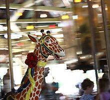 Giraffe on the Carousel by nimbusphoto