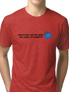 This is my cup of care. Oh look, it's empty! Tri-blend T-Shirt