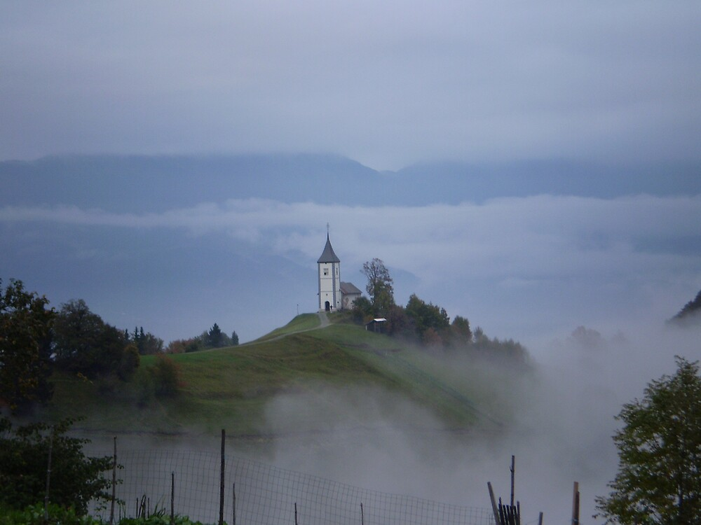 Church in clouds, Slovenia by oscars