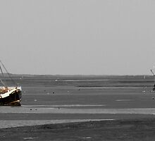 A black & white image of two fishing boats grounded off the North Norfolk coast with one inspot colour by johnny2sheds