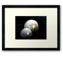 Glass globes covered with frost a pin point of sunshine bursts intothecolours of a rainbow Framed Print