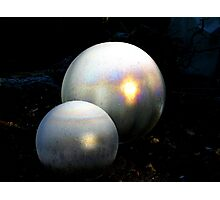 Glass globes covered with frost a pin point of sunshine bursts intothecolours of a rainbow Photographic Print