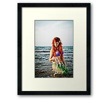 Mermaid sighting on the beach  Framed Print