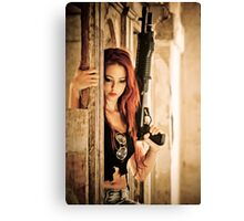 Aggressive Young woman of 24 with automatic rifle  Canvas Print