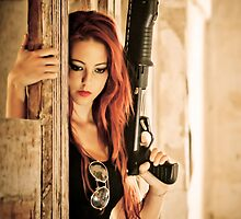 Aggressive Young woman of 24 with automatic rifle  by PhotoStock-Isra